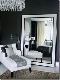 If you want to bring a little light, some drama and more space – or the illusion of space – into a room, try an oversized mirror.