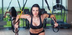 attractive woman does crossfit push ups with trx fitness straps in the gyms studio , Crossfit Gym, Trainer, Social Media Graphics, Push Up, Bikinis, Swimwear, Workout, Trx Fitness, Women