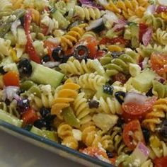 Greek pasta salad: 2 cups penne pasta 1/4 cup red wine vinegar 1 tablespoon lemon juice 2 cloves garlic, crushed 2 teaspoons dried oregano salt and pepper to taste 2/3 cup extra-virgin olive oil 10 cherry tomatoes, halved 1 small red onion, chopped 1 green bell pepper, chopped 1 red bell pepper, chopped 1/2 cucumber, sliced 1/2 cup sliced black olives 1/2 cup crumbled feta cheese