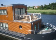 LIVING THE LIFE AQUATIC ON A WATERLIVING HOUSEBOAT Waterliving, Danish Houseboats, Copenhagen, water architecture – Inhabitat - Sustainable Design Innovation, Eco Architecture, Green Building