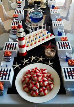 Nautical Sailor Party Table The donuts are adorable; what are the red stripes made from? Fruit roll ups? Sailor Birthday, Baby Birthday, 1st Birthday Parties, Anchor Birthday, Sailor Baby Showers, Baby Boy Shower, Baby Showers Marinero, Sailing Party, Sailor Theme