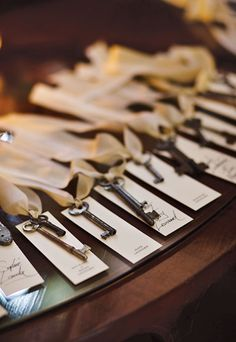 Escort cards made with tags that combined type and handwriting, and were each tied to a vintage skeleton key. Joyelle West Photography.