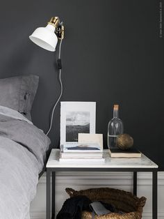 Dark grey wall in the bedroom of the dreamy home of Sara Medina Lind.