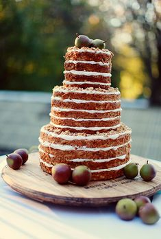Brides.com: . A three-tiered naked apple walnut wedding cake, decorated with fresh apples, created by Magpies Cakes.