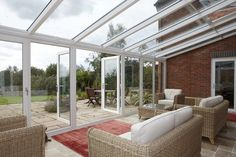 REHAU uPVC French Doors opens up conservatory to the garden. All our doors are custom made. See them at www.weatherglaze2000.com/french-doors/
