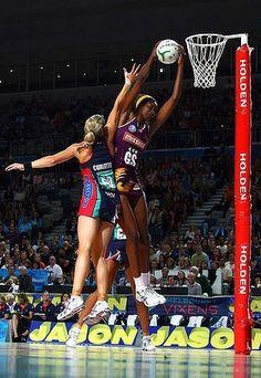 ANZ 2012 Tall order: Firebird Romelda Aiken gets the ball over Vixen Julie Corletto yesterday.