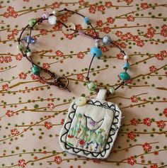 textile pendant from hens teeth Textile Jewelry, Fabric Jewelry, Beaded Jewelry, Jewellery, Fabric Brooch, Free Motion Embroidery, Lavender Bags, Fabric Beads, How To Make Beads