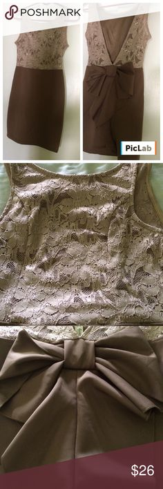 "EUC dress Gorgeous coming & going!!!...Sleeveless, tan, lace top with gold threading...Brown skirt...Panel with bow on plunging back...top is lined in front...Dress is 32"" from shoulder to bottom...Bow in back is 10"" across...66% nylon//30% polyester//4% spandex...perfect for a wedding or special event!!...Never Worn Lovely Day Dresses"