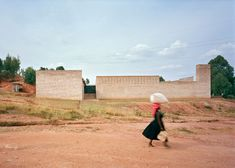 Education centre in Rwanda built from brick and wicker by Dominikus Stark Architekten