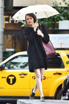 Emma Stone's Best NYC Outfits #refinery29  http://www.refinery29.com/2014/12/79691/emma-stone-best-new-york-outfits#slide-3  It's tough to look good when you're caught in the rain. Yet, Emma pulls it off, contemplating whether she should cross a flooding intersection in her leather slip-ons. But, holding on to her umbrella and keeping her trusty tote close, she takes the leap.