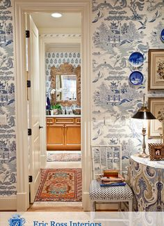 Eric Ross Interiors | Layering different blue and white chinoiserie wallpaper for cohesive dimension.
