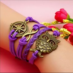 Purple owl nautical commas infinity bracelet Infinity bracelet as pictured colors May look different on bracelet than picture shows. Sometimes it is hard to get an accurate picture. Bundle with another bracelet 2/$12. The other picture is an example of what the back looks like Jewelry Bracelets