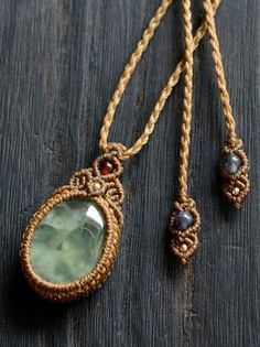 macrame pendant with stone.  Interesting tie closure