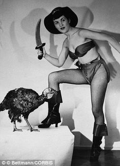 Bloodthirsty buccaneer: Flo Bondi, who was Miss Ohio of 1949, is seen threatening a turkey with a curved knife while promoting the film The Pirates of Capri