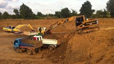 Cat excavator digging pond | Excavator loading truck in deep hole | Best...