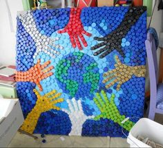 Want to have a bottle cap mural in the media center. Hands Around the World. A bottle cap work of art! Bottle Cap Projects, Bottle Cap Crafts, Plastic Bottle Caps, Plastic Art, Plastic Recycling, Recycle Plastic Bottles, Recycled Art Projects, Recycled Crafts, Recycled Magazines