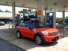 Mini Cooper Countryman With A Lot Of Gear On The Roof.
