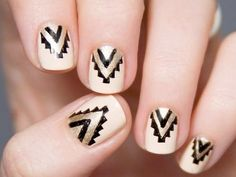 White Nails with Metallic Chevron Designs