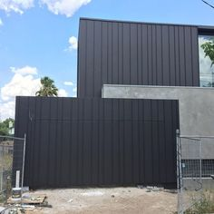 Beautiful Malvern Residence finished off in Elzinc Jet Black. Notice the concealed garage door. Supplied and Installed by Archclad. Timber Garage Door, Black Garage Doors, Craftsman Front Doors, Modern Garage Doors, Garage Door Design, House Cladding, Exterior Cladding, Facade House, Modern House Facades