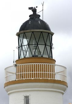 The Light On Top Of Chanonry Point Lighthouse, Inverness.  , Year Established: 1846. Engineer: Alan Stevenson. Position Latitude 57° 34.441'N. Longitude 004° 05.567'W. Character – Occulting White every 6 Secs. Elevation – 12 metres. Nominal Range – 15 nautical miles. Structure – White tower 13 metres high. There are 48 steps to the top of tower.