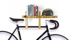 Impress Wall Mounted Wood Bicycle Rack Design Inspiration Featuring Reclaimed Wooden Material Bike Wall Mounted Rack And Black Sport Bike With Black Helm And Assorted Books