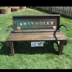 Tailgate Bench - so cool! Babe maybe we could find an old GMC tailgate and get it painted the green, be a whole lot cheaper than the entire truck and cool in the backyard!