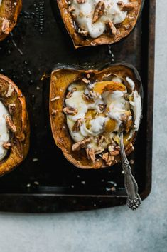 Delicious breakfast acorn squash baked with spices and stuffed with yogurt, pecans and a drizzle of honey. The perfect protein-packed meal to start your morning!