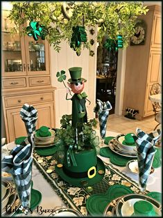 Ireland Pursuit St. Patrick's Day Table. Combine a DIY leprechaun centerpiece with Ireland Pursuit dish pattern and chandelier decorated with garland greenery and shamrock ornaments.