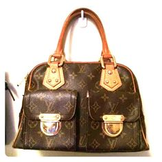 Authentic Louis Vuitton Manhattan PM!! Absolutely stunning 100% authentic Louis Vuitton Manhattan PM bag! Retailed for $1680 plus tax!! Absolutely great condition! One small mark inside lining, and slight normal wear on corner, but everything else is PERFECT! Date code is TH0035! Price negotiable. This same bag in worse condition is selling on sites for much more . Cheaper on ♏️ercari! Louis Vuitton Bags Satchels