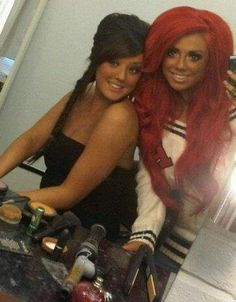 Besides the fact that these girls need to stop tanning, I love how the girl on the left styled her hair.