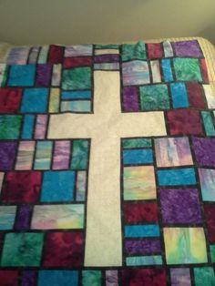 Custom order stained glass fabric cross quilts from www.threestrandsquilting.com