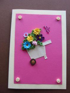 Tarjeta rosa, decorada con carreta de flores