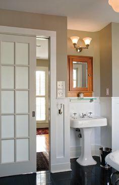 I love the pocket door in this bathroom! Classic beauty.