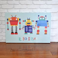 Hey, I found this really awesome Etsy listing at https://www.etsy.com/listing/152732566/robots-rule-canvas-wall-art