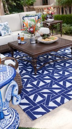 An elaborate maze of intertwining lines within the Caning Outdoor Rug adds symmetry and character to outdoor living spaces. | Frontgate: Live Beautifully Outdoors