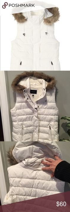 NWT Banana Republic Faux Fur Puffer Vest New condition, detachable drawcord hood with hidden zipper, 2 front zip pockets, fully lined, quilted pattern filled with polyester fibers. Just enough to keep you warm but not too much where you look like a Human marshmallow. Fur color very soft. Coat material, extremely soft feeling. Looks very expensive. Sz Large Banana Republic Jackets & Coats Vests