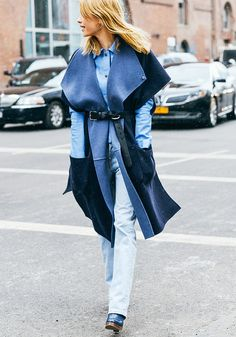 Two-tone cape, chambray button-down, and light wash jeans