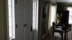 Front entryway. Two nice large transom windows.