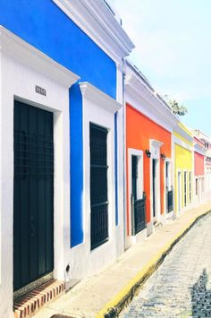 Puerto Rico Old Town San Juan colors - the old streets have brightly coloured homes and buildings in blue, orange and even yellow. It must be one of the most colorful places in the world.