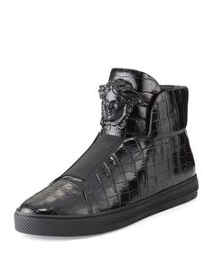 """Versace """"Palazzo Idol"""" high-top sneaker in crocodile-embossed leather adorned with the signature Medusa head. Round toe. Laceless vamp with elastic strap. Padded tongue and collar. Slip-on style. Leat"""