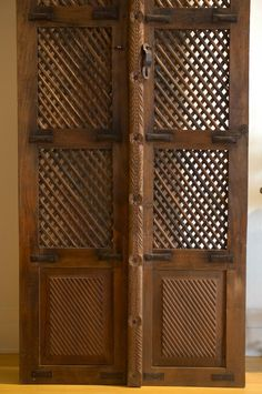 Gorgeous vintage lattice doors, hand carved with iron details.