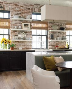 brick, shelves, black cabinets, island, light