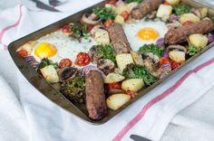 Veggie Brunch Tray Bake - Kay's Kitchen Baked Eggs, Baked Potato, Turkish Eggs, Poached Eggs, Cherry Tomatoes, Tray Bakes, Kale, Sausage, Spicy