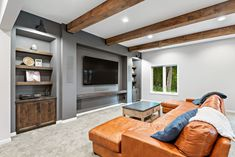 This cozy dark wood basement is the perfect place to curl up for the winter. Ready for entertaining at the holidays, this basement includes a custom built wet bar, home theater, home office, and game room. Start your custom basement remodel today with FBC Remodel in Colorado, Minnesota, and Illinois. Finished Basement Company, Living Area, Living Spaces, Basement Inspiration, Basement Remodeling, Remodels, Bars For Home, Home Theater, Dark Wood