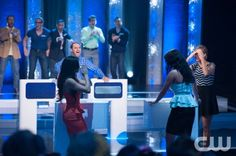 """Perfect Score -- """"Banking on Love"""" -- Image Number PS_107_034.jpg -- Pictured: Host Arielle Kebbel (far right) with contestants Photo: Eddy Chen/The CW -- © 2013 The CW Network, LLC. All rights reserved."""