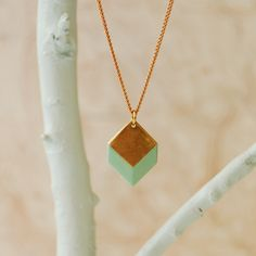 Geometric Necklace, Brass 3D Geometric, The Sabine Square II. $38.00, via Etsy.