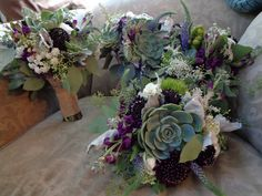 Bridesmaid bouquets of Succulents, dark purple and burgundy flowers, mixed with sage greens. Flowers by B&B Designs www.bandbflowerdesigns.com