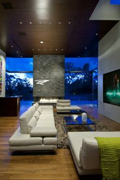 luxury-family-home-with-transparent-walls-and-bowling-alley-12.jpg **Stone wall with heater; TV on wall looks good! Light is a great feature!