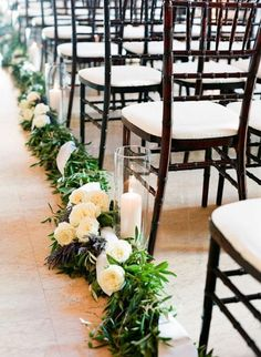 Greenery along aisle, with floral accents and/or candles/lanterns. More delicate look than this though, less heavy.