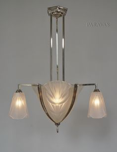 DeguÉ A French 1930 Art Deco Chandelier In Nickel Plated Bronze Holding Moulded Pressed Glass
